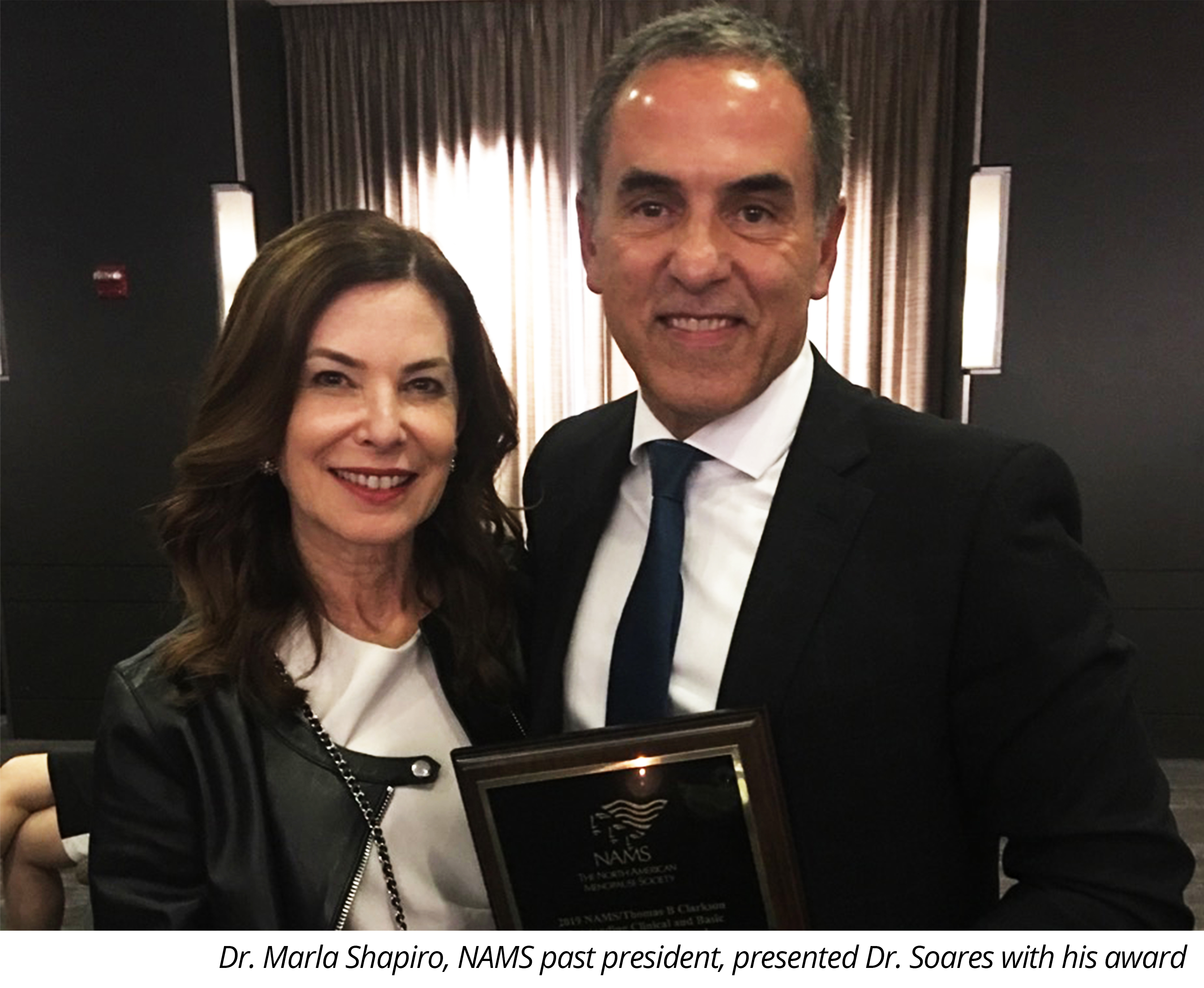 Dr. Marla Shapiro, NAMS past president, presented Dr. Soares with his award