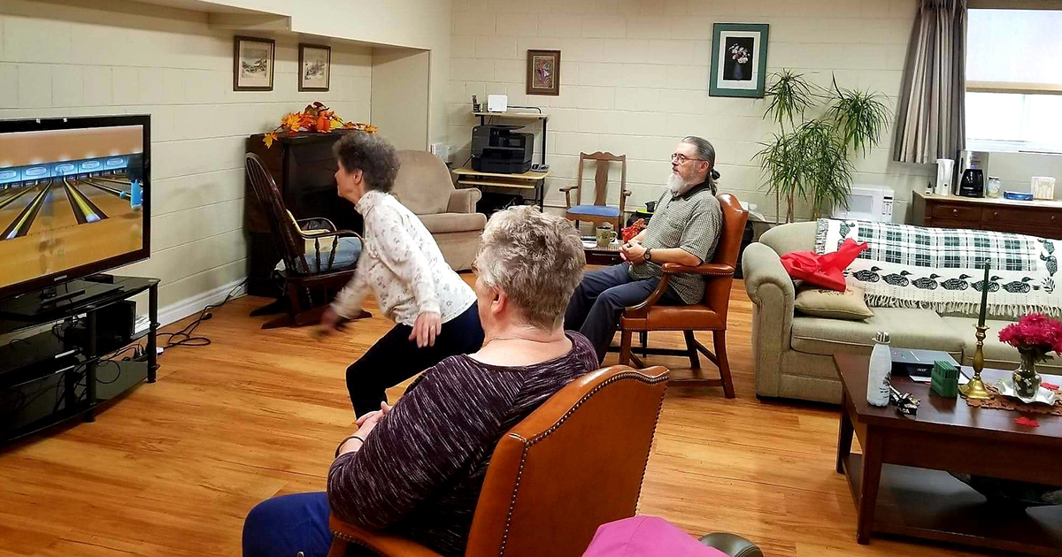 As part of the Oasis Senior Supporting Living program Pearl Larson tries her hand at Wii-bowling, while Norm Fournier and Evelyn Farrar look on.