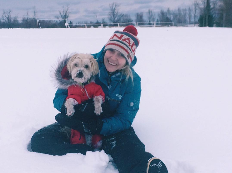 Sarah in the snow with her dog Odin (taken from her Instagram)
