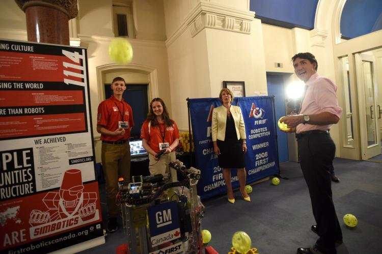 Prime Minister Justin Trudeau and Dr. Mona Nemer, Canada's new chief science adviser, check out a robot that launches balls, with science fair participants Van Bernat and Kate O'Melia of Governor Simcoe Secondary School in St. Catharines, Ont., on Parliament Hill in September. (THE CANADIAN PRESS/Sean Kilpatrick)