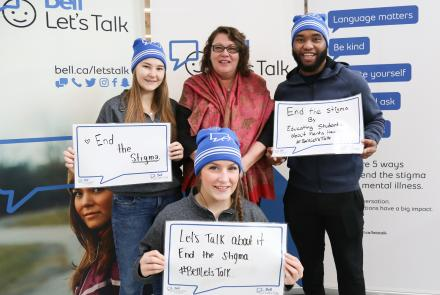 Dr. Heather Stuart with students at a Bell Let's Talk event at Queen's