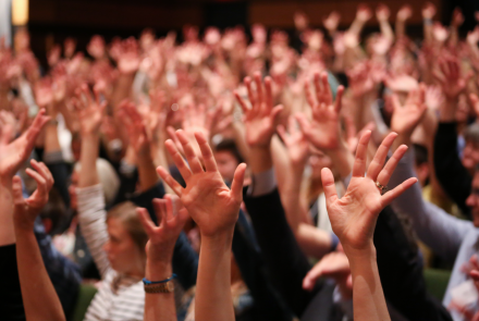 Hands raised at the first annual employee engagement event.